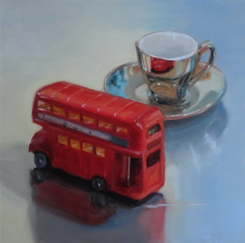 realistic painting of a shiny teacup with a model London red bus on a reflective surface