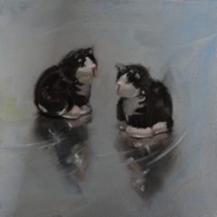 Still life oil painting of a ceramic crest set in the shape of black and white cats
