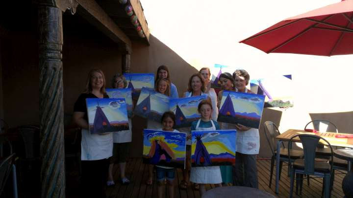 Painting class students display their sunset teepee paintings