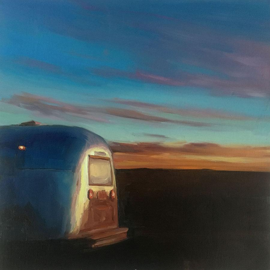 vintage airstream reflecting a sunrise