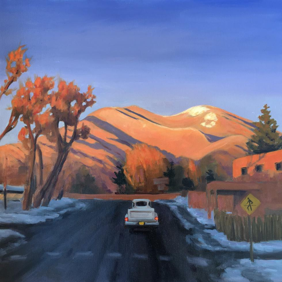 painting of the main road through Taos with the mountain lit up by the setting sun